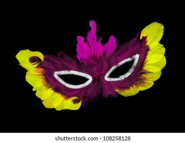 Fancy vintage purple / pink / yellow feathers with sequin dress mask isolated on black background