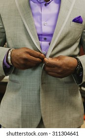Fancy Wedding Groom in Suit With Purple Accents