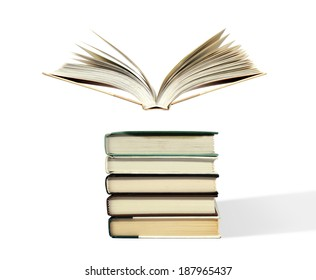 Fanned book floating above stack