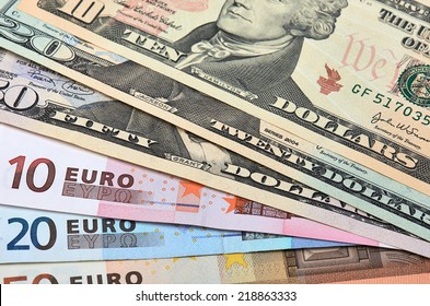 Fanned Out Banknotes Of Euros And Dollars Closeup