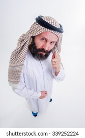 Fanny arabic man poses with emotions.Shut from above with wide angle lenses.