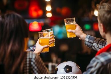 Fans celebrates win of favorite team in sports bar