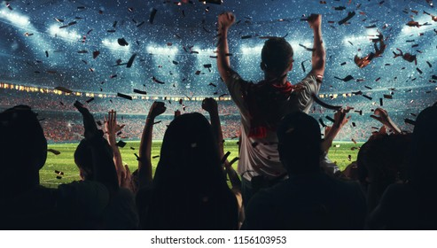 Fans celebrating the success of their favorite sports team on the stands of the professional stadium while it's snowing. Stadium is made in 3D.