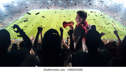Fans celebrating the success of their favorite sports team on the stands of the professional stadium. Stadium is made in 3D.
