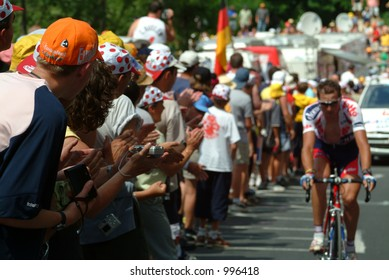 Fans cheer on a rider at the Alpe D'Huez stage of the 2004 Tour de France