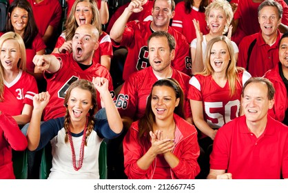 Fans: Crowd Of Cheering Football Fans In Stadium Seats