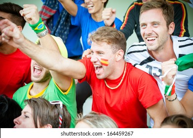 Fans of different nations at the stadium together - Stock Image