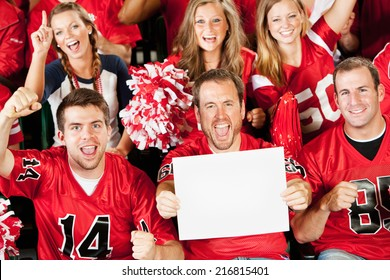 Fans: Football Fan Holds Up Blank Sign While Cheering