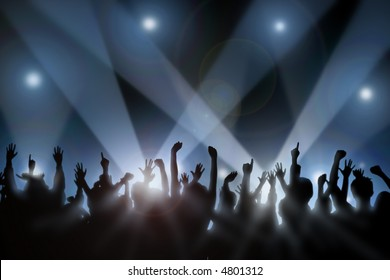 Fans raise their hands at concert