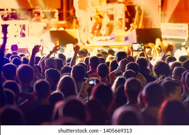 fans and rock musicians during the performance. Web banner.