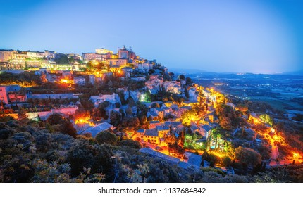 Fantastic aerial night view on ancient town Gordes in Provence, France. Luberon national park. Gordes is famous and popular travel destination in Provence, one of iconic Provencal landmarks.
