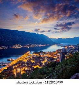 Fantastic aerial panoramic summer view from the mountain to the bay of Kotor, Mediterranean Balkans, Montenegro, Europe. Traveling concept background. Incredible street lights in the sunset. Postcard