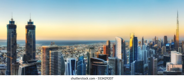 Fantastic aerial view over a big modern city with skyscrapers. Downtown Dubai, United Arab Emirates. Colourful panoramic skyline.