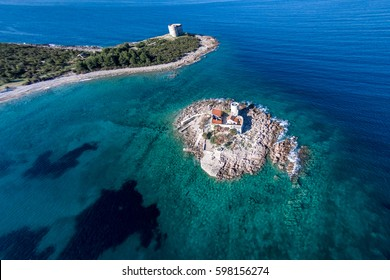 Fantastic aerial view of the Saint Virgin monastery and fortress Arza Lustica peninsula. Montenegro. Adriatic sea