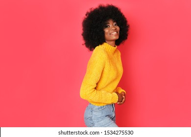 Fantastic afro girl with big smile isolated on red background.