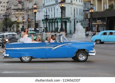 The fantastic American retro cars whith characteristic and traditional Cuban party of fifteen years Quinceañera Habana Cuba August 2013