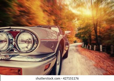Fantastic asphalt road in the mountains. Classic car.
