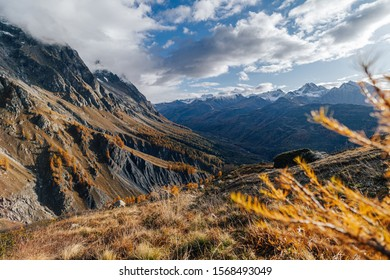 Fantastic autumn mountain landscape. Late fall in the mountians. Yellow grass, meadows and high peaks covered with snow. Autumn in Chamonix and Courmayer area, Mont Blanc, Alps. Beautiful autumn day.