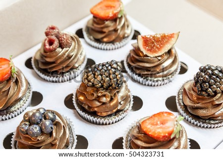 Fantastic Beautiful Chocolate Cupcakes Berries Gold Stock Photo