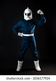 A fantastic character, an astronaut or a stormtrooper, shows the bicep. man in overalls and a helmet