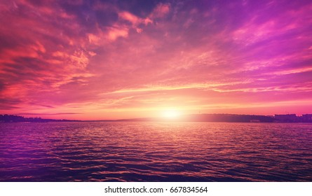 fantastic colorful landscape.  overcast clouds glowing in sunlight at sunset over the lake. picturesque view. color in nature. natural creative picture. instagram toning