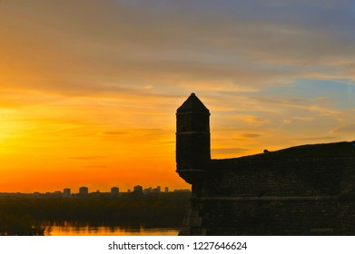 Fantastic colorful sunset with Old castle stone brick walls,  ruins, Danube river and park in the Kalemegdan fortress Belgrade Serbia