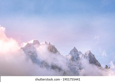 Fantastic dawn snow mountains landscape background. Colorful pink and blue clouds overcast sky. French Alps, Chamonix Mont-Blanc, France