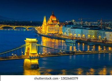 Fantastic European touristic travel destination. Amazing cityscape panorama with famous iluminated Chain bridge and Hungarian Parliament building on Danube river at twilight, Budapest, Hungary, Europe