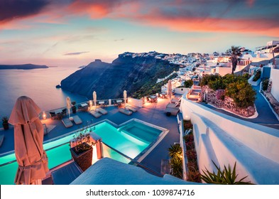 Fantastic evening view of Santorini island. Picturesque spring sunset on famous Greek resort Fira, Greece, Europe. Traveling concept background. Artistic style post processed photo.