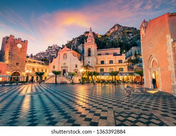 Fantastic evening view of Taormina town, IX Aprile plaza with San Giuseppe church and old fortress on background, Sicily, Italy, Europe. Traveling concept background.
