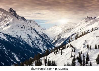 Fantastic evening winter landscape. Colorful overcast sky. Austria, Europe. Beauty world.