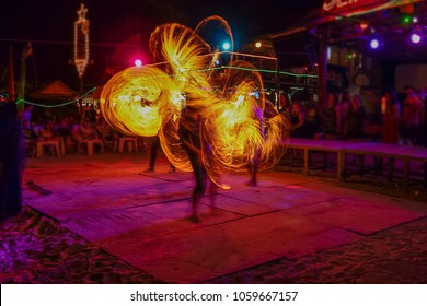 Fantastic Fire Show on the beach with colorful of fire moving, party full moon night life on the beach, Phi Phi island, Krabi, Thailand.