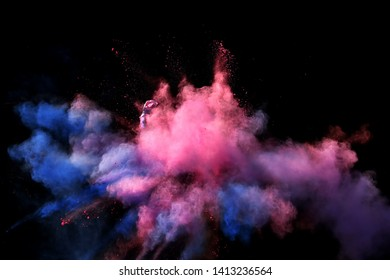 Fantastic forms of powder paint and flour combined  together explode in front of a black background to give off fantastic  color explosions in bizarre multi colored cloud forms.