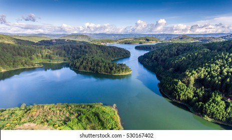 Fantastic landscape of eco lake for travel at Dalat, Viet Nam, fresh atmosphere, villa among forest, impression shape of hill and mountain from drone view