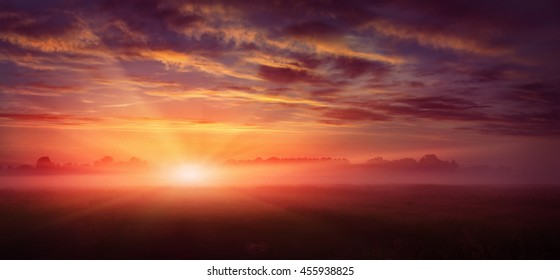 fantastic landscape. majestic misty morning over meadow. colorful sky with overcast clouds, under the influence of sunlight. dramatic picturesque scene. beauty of the world. creative images