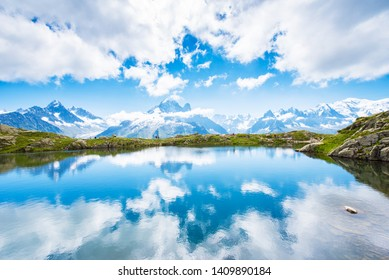 Fantastic landscape with reflection of mountains in the lake on the background of Mont Blanc, French Alps, Europe. (Harmony, tourism, meditation - concept)