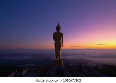 Fantastic Light with Golden buddha statue in Khao Noi temple at sunrise, Nan, Thailand