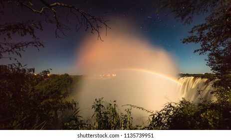 Fantastic lunar rainbow during the night over Victoria Falls Mosi oa Tunya - Zambia and Zimbabwe, Africa