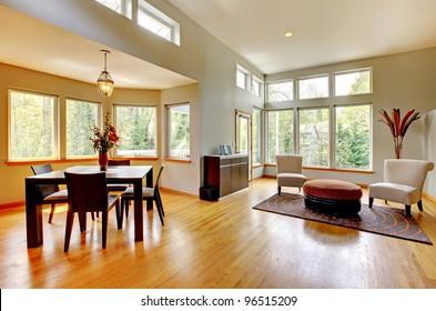Fantastic modern living room home interior. Dining room. Huge green bright room with modern furniture.