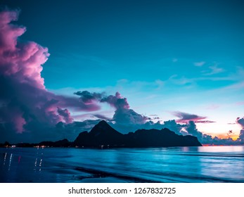 Fantastic morning blue sea glowing by sunlight.Beach by the sea with mountains in the bay of the sea in southern Thailand.
