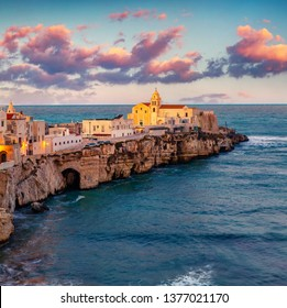 Fantastic morning cityscape of Vieste - coastal town in Gargano National Park, Italy, Europe. Incredible spring sunrise on Adriatic sea. Traveling concept background.