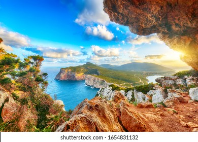 Fantastic morning view on Cacccia cape. View from the cave on the cliff. Fantastic  Mediterranean seascape. Location:  Alghero, Province of Sassari, Italy, Europe