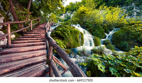 Fantastic morning view of Plitvice National Park. Colorful spring scene of green forest with pure water waterfall. Beautiful countryside landscape of Croatia, Europe. Traveling concept background.