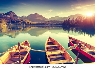 Fantastic mountain lake in National Park High Tatra. Dramatic scenery. Strbske pleso, Slovakia, Europe. Beauty world. Retro style filter. Instagram toning effect. - Shutterstock ID 205250962