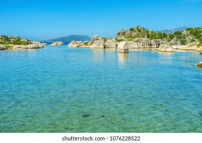 Fantastic nature of Kekova - the unique resort, offering best conditions for beach lovers, yachting, fans of archeology, here locate ruins of Lycian civilization, Simena, Kalekoy, Turkey.