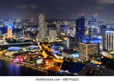 Fantastic night view of downtown in Singapore. Amazing skyscrapers and other modern buildings on dark sky background. Top view of Raffles Avenue. Beautiful cityscape.