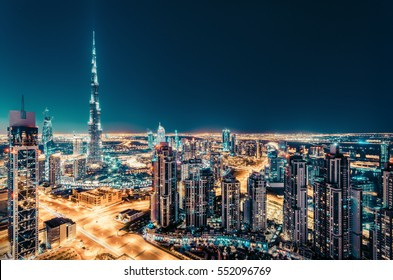 Fantastic nighttime skyline with illuminated skyscrapers. Elevated view of downtown Dubai, UAE. Colourful travel background.