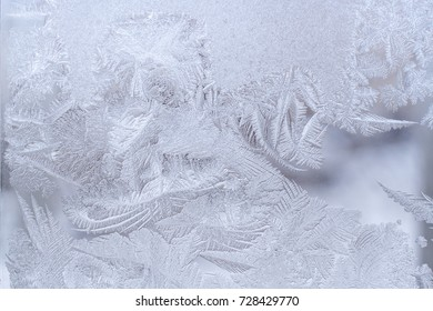 Fantastic ornate frosty pattern on winter window glass.