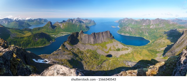 Fantastic panoramic view from the mountain Grytetippen (Senja island. Norway) over the Øyfjorden with view to Mefjorden, Segla, Fjordgård, the rock wall of Keipan and the beautiful island Husøy.