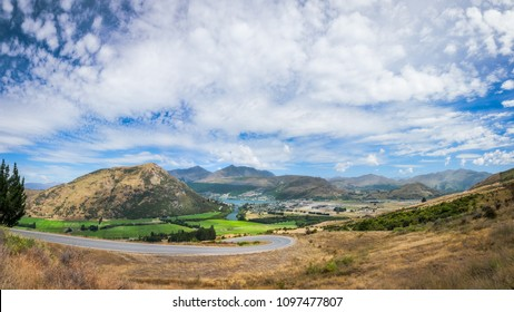 Fantastic Panoramic views of the town and alpine scenery the from the winding road that connects Queenstown with the Remarkable Ski Area on a beautiful summer day.